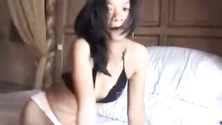 Sexy Asian girl in her bra and panties on her webcam playing