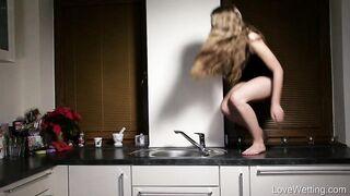 Julia pissing in the sink - Pee