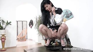 Pee: Exotic looking Akasha Coliun spraying her warm pee and masturbating on top of a table